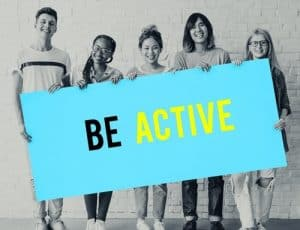 Students holding Be Active poster - School Physical Activity Program