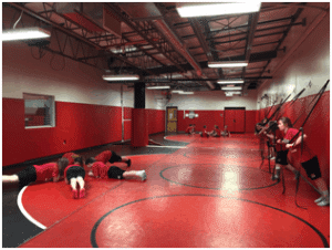 Students training in a gym