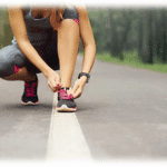 Runner tying her shoe: promoting physical activity