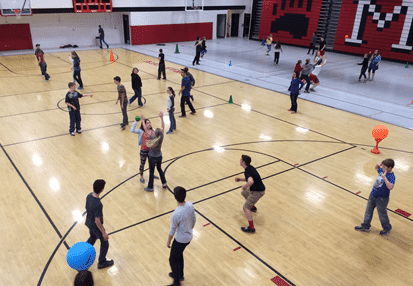 Students playing PE target games