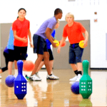 Students playing foam ball activities