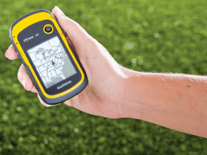 Hand holding GPS unit for Geocaching