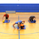 Students performing medicine ball exercises
