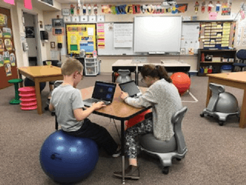 Students sitting on active seats