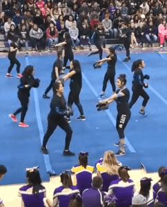 Students kick boxing during fitness dance routines