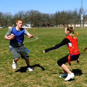 Students playing flag football
