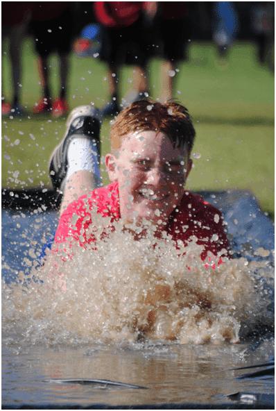Student using slip and slide